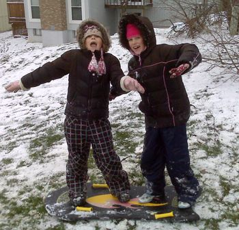 Judiann and Mary snowboarding